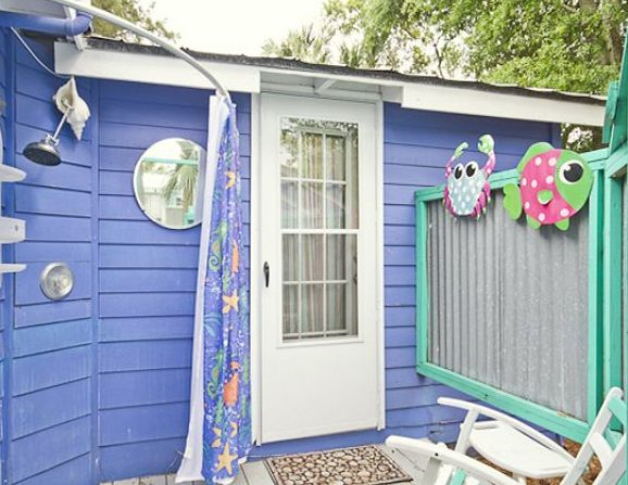 Fish Camp Cottage circa 1924 is a bright and cheerful cottage with screened porch, fenced-in yard, partial marsh views from the back deck.  It's pet friendly, too!