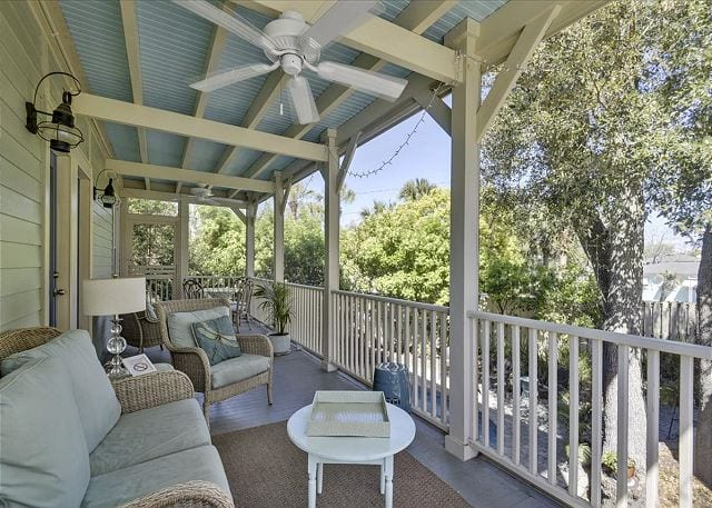 the glorious porch of whispering palms cottage