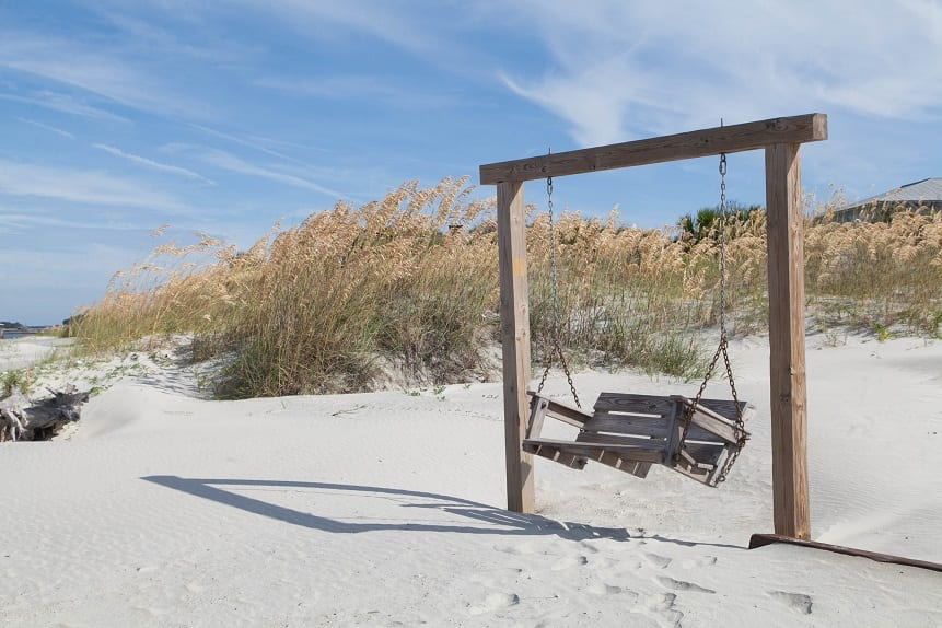 Mommas don't let your babies miss sitting in this tybee island beach swing