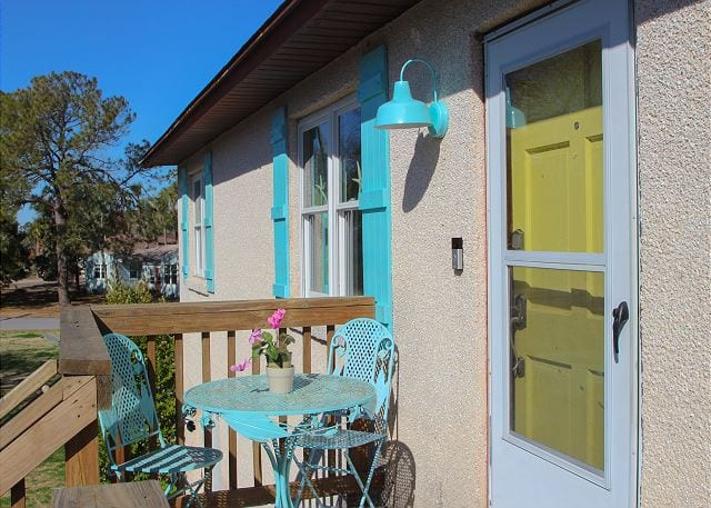 The yellow Tybee Island door at Coastal Joy Cottage