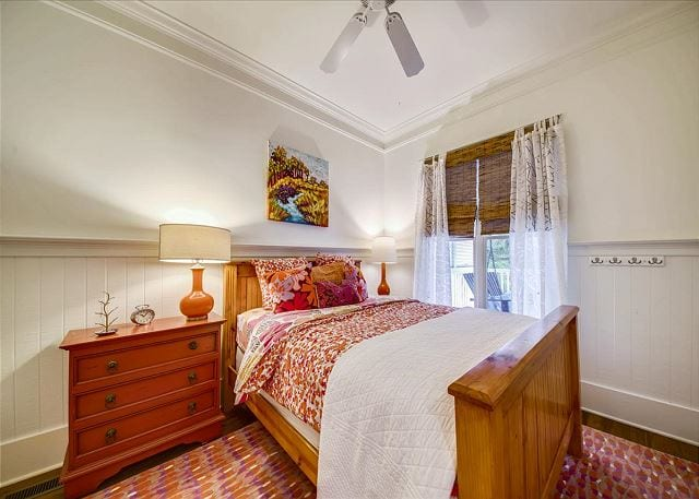 a queen bedroom at a wave call cottage