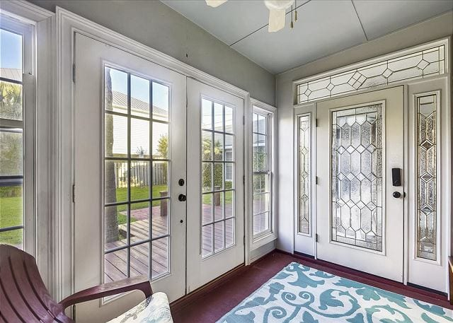 beautiful glass doors leading onto the deck at beach haven cottage