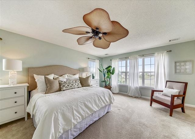 the master bedroom at marsh mermaid duplex on tybee island ga