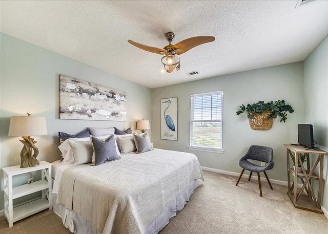 the master bedroom at marsh mermaid vacation rental