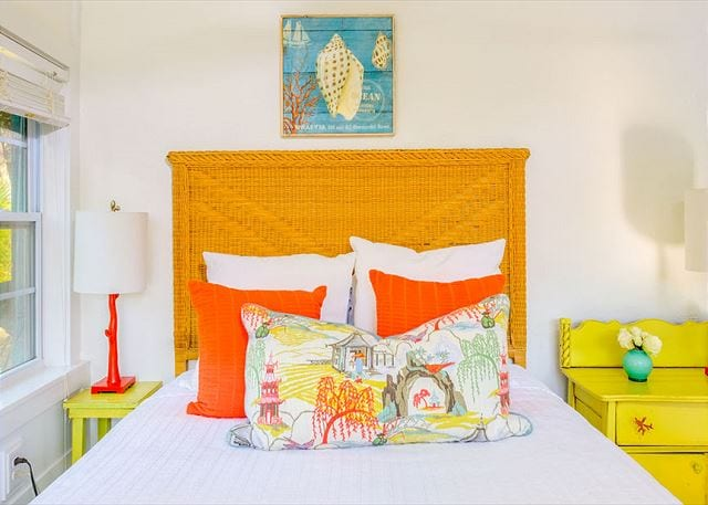 we love bursts of orange in the bedroom