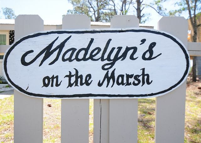 we love the hand painted sign at madelyn's on the marsh cottage