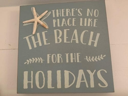 holiday sign at tybee tides cottage